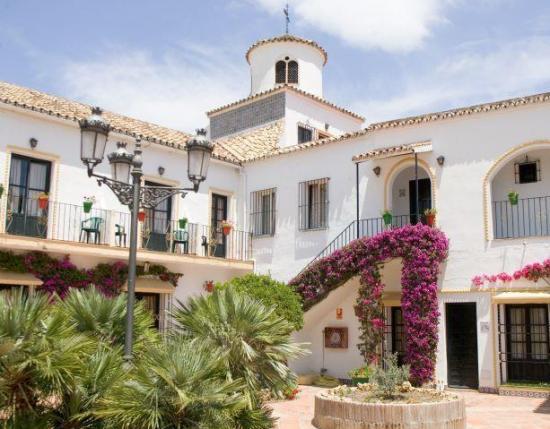 Hi pueblo andaluz hotel en san pedro de alc ntara for Hotel pueblo andaluz